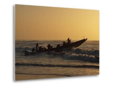 Fishermen Launch their Boat into the Atlantic Ocean at Sunset-Amar Grover-Metal Print