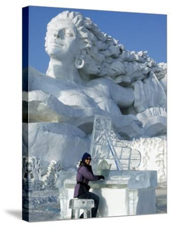 Harbin City, A Tourist Is Playing a Sculpted Ice Piano, Snow and Ice Festival, China-Christian Kober-Stretched Canvas Print