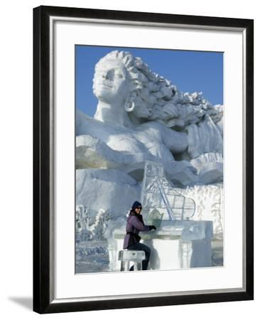 Harbin City, A Tourist Is Playing a Sculpted Ice Piano, Snow and Ice Festival, China-Christian Kober-Framed Photographic Print