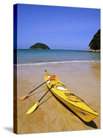 South Island, Nelson, Kayak on Onetahuti Beach in Abel Tasman National Park, New Zealand-Christian Kober-Stretched Canvas Print