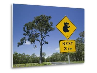 Queensland, Fraser Coast, Maryborough, Koala Crossing Sign on the Bruce Highway, Australia-Walter Bibikow-Metal Print