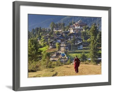 Monk Leaving Gangtey Dzong, and Village, Phobjikha Valley, Bhutan-Peter Adams-Framed Photographic Print
