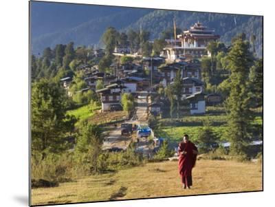 Monk Leaving Gangtey Dzong, and Village, Phobjikha Valley, Bhutan-Peter Adams-Mounted Photographic Print