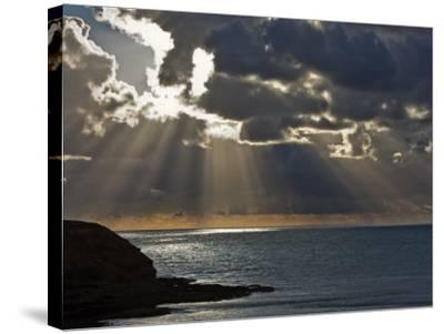 Victoria, Sun's Rays and Clouds across the Sea at Phillip Island, Australia-Nigel Pavitt-Stretched Canvas Print