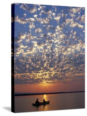 Canoeing under a Mackerel Sky at Dawn on the Zambezi River, Zambia-John Warburton-lee-Stretched Canvas Print