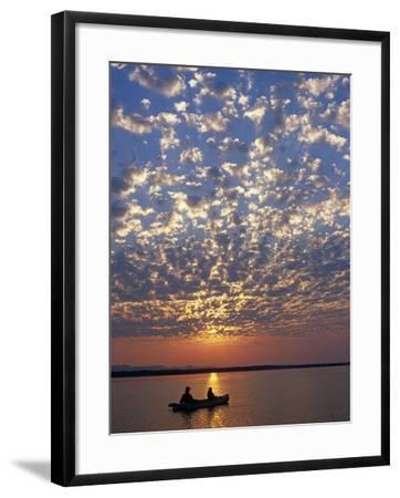 Canoeing under a Mackerel Sky at Dawn on the Zambezi River, Zambia-John Warburton-lee-Framed Photographic Print