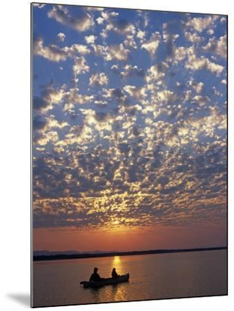 Canoeing under a Mackerel Sky at Dawn on the Zambezi River, Zambia-John Warburton-lee-Mounted Photographic Print