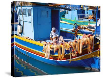 Fisherman Knotting a Fishing Net, Marsaxlokk, Malta, Mediterranean, Europe-Sakis Papadopoulos-Stretched Canvas Print