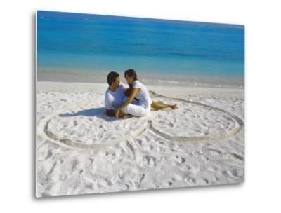 Young Couple on Beach Sitting in a Heart Shaped Imprint on the Sand, Maldives, Indian Ocean, Asia-Sakis Papadopoulos-Metal Print