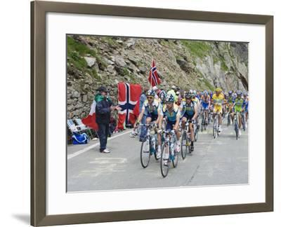 Cyclists Including Lance Armstrong and Yellow Jersey Alberto Contador in the Tour De France 2009-Christian Kober-Framed Photographic Print