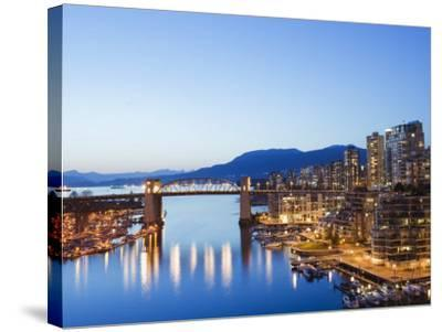 Illuminated Buildings in False Creek Harbour, Vancouver, British Columbia, Canada, North America-Christian Kober-Stretched Canvas Print