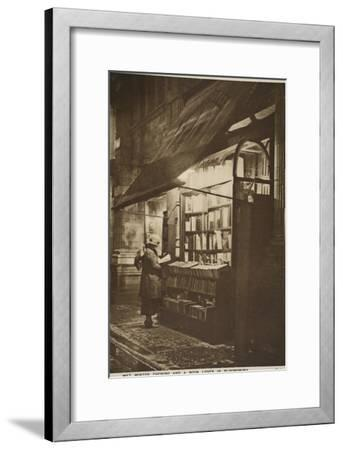 Examining a Book Outside a Second Hand Bookshop on a Wet Winter Evening, Bloomsbury--Framed Giclee Print