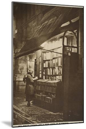 Examining a Book Outside a Second Hand Bookshop on a Wet Winter Evening, Bloomsbury--Mounted Giclee Print