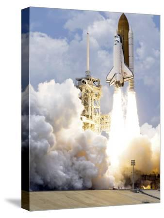 Space Shuttle Atlantis Lifts Off from its Launch Pad--Stretched Canvas Print