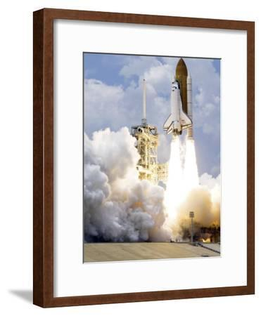 Space Shuttle Atlantis Lifts Off from its Launch Pad--Framed Photographic Print