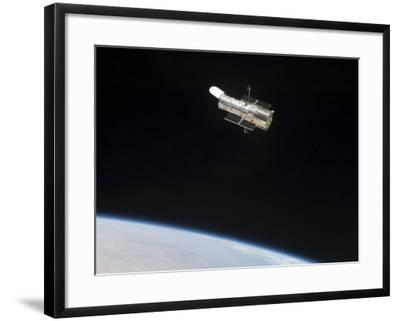 The Hubble Space Telescope in Orbit Above Earth--Framed Photographic Print