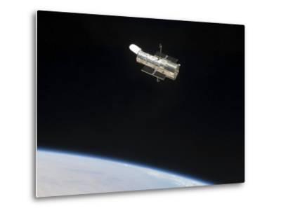 The Hubble Space Telescope in Orbit Above Earth--Metal Print