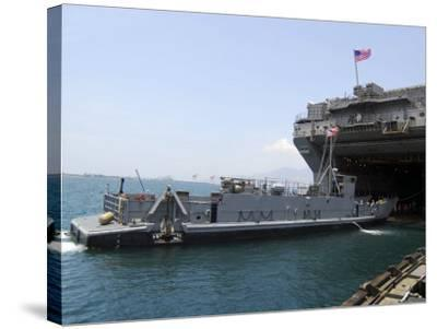 Landing Craft Utility Near Amphibious Assault Ship USS Essex in Subic Bay, Philippines--Stretched Canvas Print