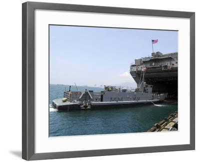 Landing Craft Utility Near Amphibious Assault Ship USS Essex in Subic Bay, Philippines--Framed Photographic Print