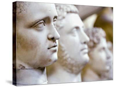 Close-Up of Statue Faces on a Shelf in the Vatican, Rome, Italy-Andrea Sperling-Stretched Canvas Print