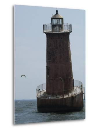 Weathered Sharps Island Light, in the Chesapeake Bay-Paul Sutherland-Metal Print
