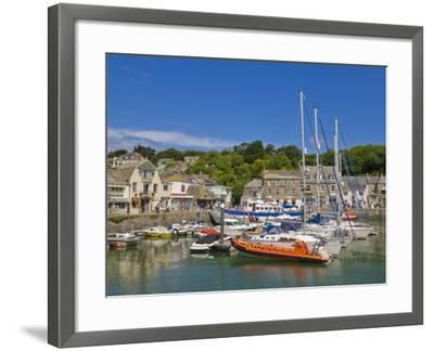 Busy Tourist Shops, Small Boats and Yachts at High Tide in Padstow Harbour, North Cornwall, England-Neale Clark-Framed Photographic Print