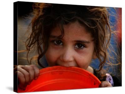Afghan Refugee Child Who Lives in Slum Area of Lahore City in Pakistan Waits to Get Water--Stretched Canvas Print