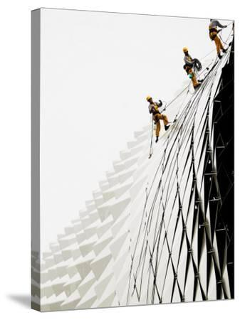Workers Climb Down the Roof of Singapore's Spikey Fruit Shaped Esplanade Arts Center--Stretched Canvas Print