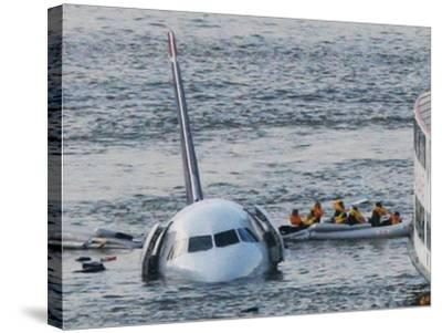 Passengers in a Raft Move from an Airbus 320 US Aircraft That Has Gone Down in the Hudson River--Stretched Canvas Print