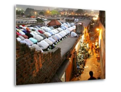 Indian Muslims During Friday Evening Prayers on the Rooftop of a Building over an Auto Parts Market--Metal Print