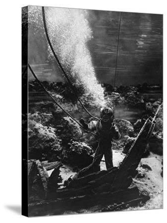 The First Photograph of a Diver at the Bottom of the Sea--Stretched Canvas Print