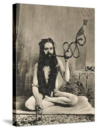 A Sadhu Smoking a Remarkable Pipe, India--Stretched Canvas Print