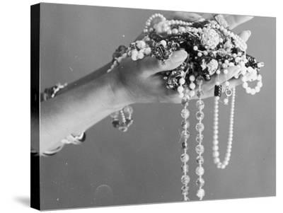 A Pair of Hands Holding All Sorts of Jewellery--Stretched Canvas Print