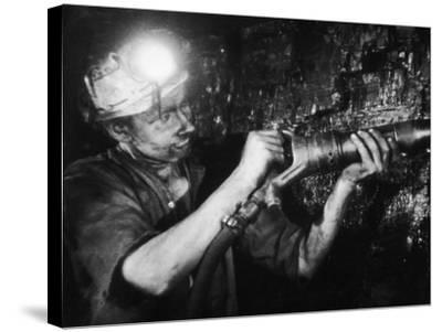 Miner Using an Hydraulic Drill at the Coal-Face, at Cape Bank Hall Pit, Burnley, in Lancashire-Henry Grant-Stretched Canvas Print