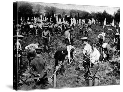 Soldiers Digging Graves for Victims of the Lusitania--Stretched Canvas Print