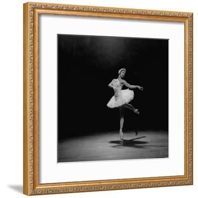 Ballerina Margot Fonteyn in White Costume Balanced on One Toe While Dancing Alone on Stage-Gjon Mili-Framed Premium Photographic Print