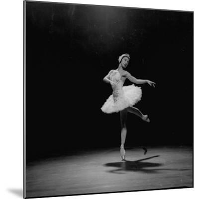 Ballerina Margot Fonteyn in White Costume Balanced on One Toe While Dancing Alone on Stage-Gjon Mili-Mounted Premium Photographic Print