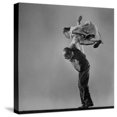 Leon James and Willa Mae Ricker Demonstrating a Step of the Lindy Hop-Gjon Mili-Stretched Canvas Print