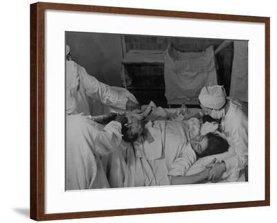 """Nurse at Her Head and Holding Her Hands, as She Gazes at Her Baby Boy after """"Painless"""" Childbirth-Alfred Eisenstaedt-Framed Premium Photographic Print"""