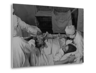 """Nurse at Her Head and Holding Her Hands, as She Gazes at Her Baby Boy after """"Painless"""" Childbirth-Alfred Eisenstaedt-Metal Print"""