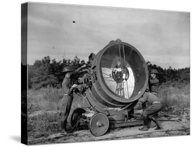 The 62nd Coast Artillery Concealing the Searchlight for Obvious Reasons-Carl Mydans-Stretched Canvas Print