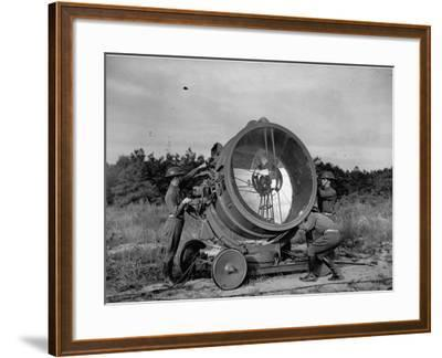 The 62nd Coast Artillery Concealing the Searchlight for Obvious Reasons-Carl Mydans-Framed Premium Photographic Print