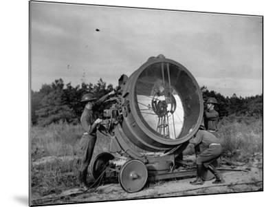 The 62nd Coast Artillery Concealing the Searchlight for Obvious Reasons-Carl Mydans-Mounted Premium Photographic Print