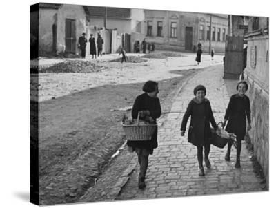 A View of Jewish Children Walking Through the Streets of their Ghetto-William Vandivert-Stretched Canvas Print