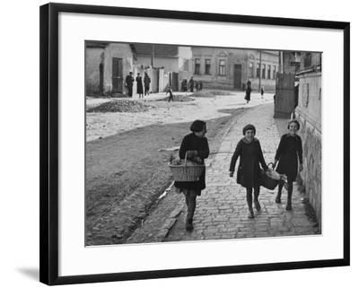 A View of Jewish Children Walking Through the Streets of their Ghetto-William Vandivert-Framed Premium Photographic Print