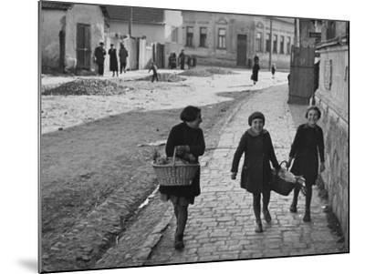 A View of Jewish Children Walking Through the Streets of their Ghetto-William Vandivert-Mounted Premium Photographic Print