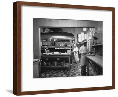 Chefs Working in the Kitchen at Gables-Peter Stackpole-Framed Premium Photographic Print