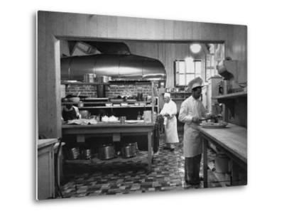 Chefs Working in the Kitchen at Gables-Peter Stackpole-Metal Print