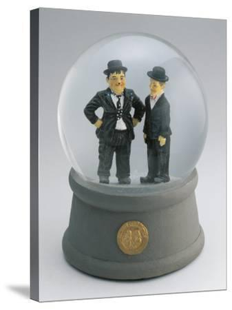 Close-Up of Figurines of Laurel and Hardy in a Snow Globe--Stretched Canvas Print