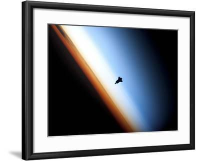 Silhouette of Space Shuttle Endeavour over Earth's Colorful Horizon--Framed Photographic Print